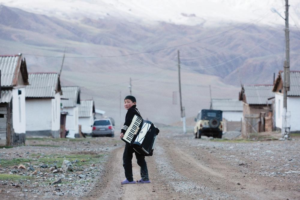 A Kyrgyz boy on the main road in the small, high-mountain village of Ak-Shyrak, a WWF project site.