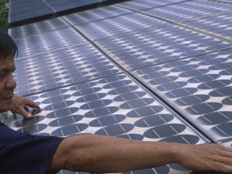Man checking solar cells