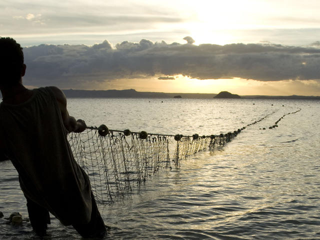 Fishermen pulling in the nets at dawn