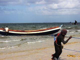 fisherman pulls in boat