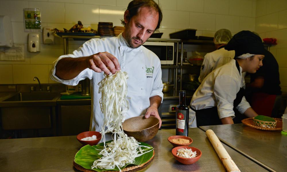a chef cooks noodles