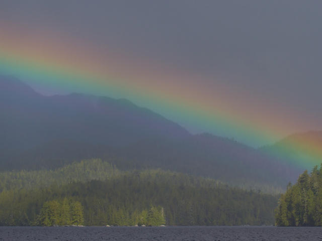 Rainbow encompassing the mountains and waters of Millbanke Sound, British Columbia, Canada