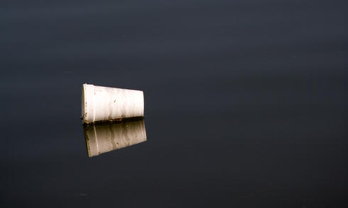 Polystyrene cup floating in water
