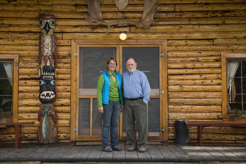 A portrait of Tim Troll and Nanci Morris Lyon, the organizers of the guide academy, in front of Kulik Lodge.