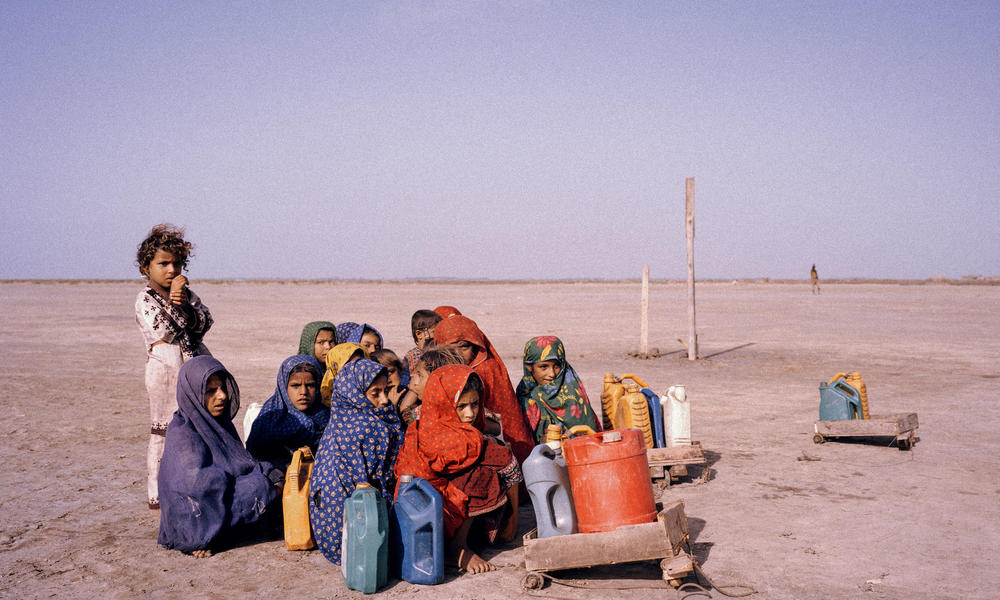 Girls collecting water