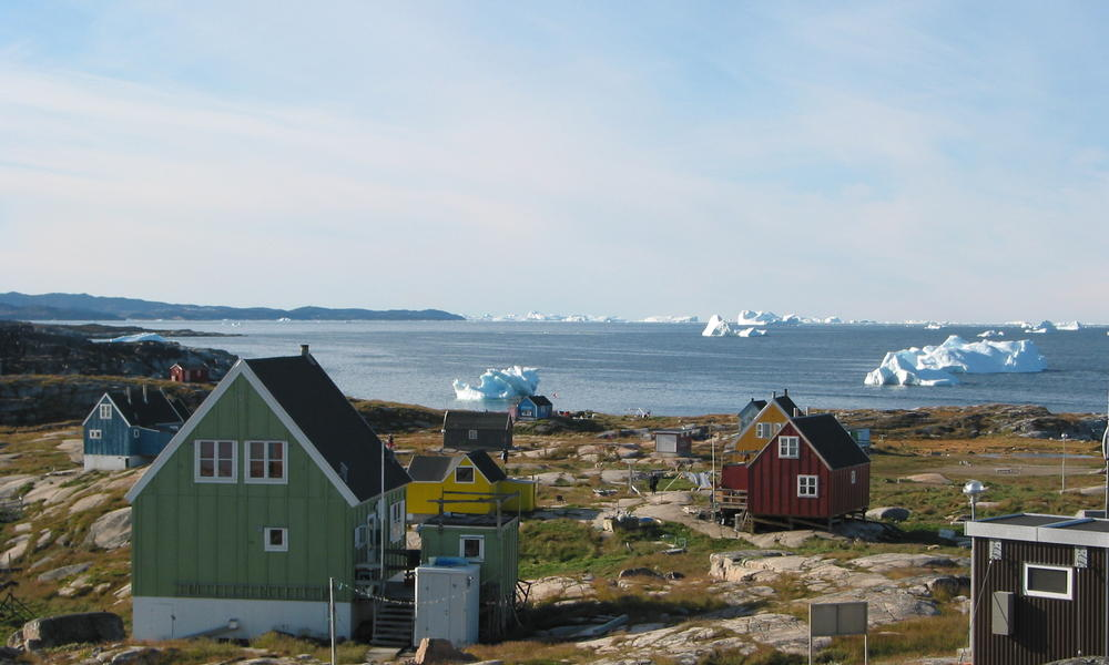 Houses and icebergs in Greenland