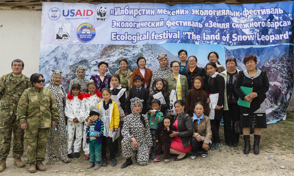People pose in their costumes from the Land of Snow Leopard festival