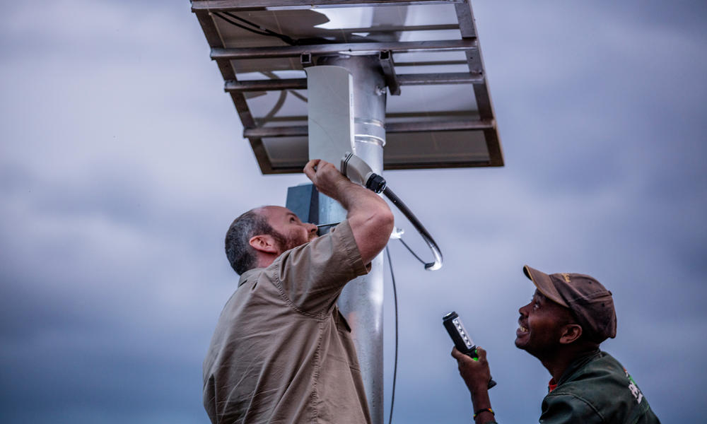 Mike Feldman, electronic security technician for Unilux installing solar panels for FLIR camera system in a National Park in central Kenya.