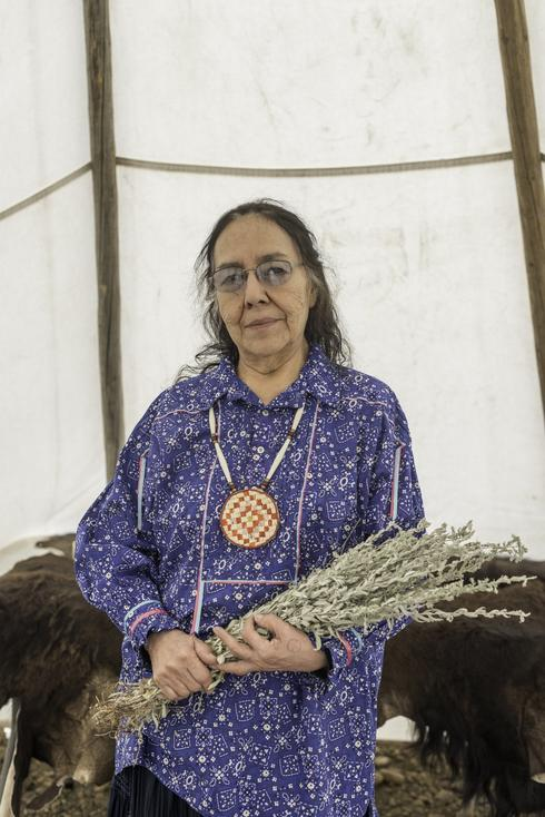 Lois Red Elk uses a bundle of sage as a prop when she performs one of the Sioux people's sacred stories