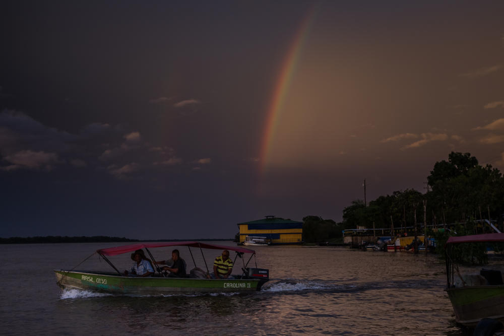 Boat on the Orinoco River with a rainbow