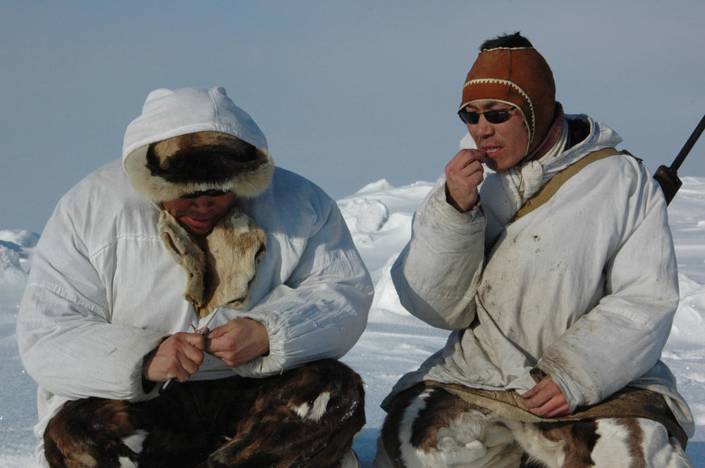 Vladilen and Sergey Kavriy, Chukchi brothers, rest and eat.
