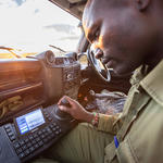 Ranger Lema Lankas tests the control board to pan and tilt the mobile FLIR camera mounted on top of the truck. The camera can focus on objects (like poachers) nearly a mile away.