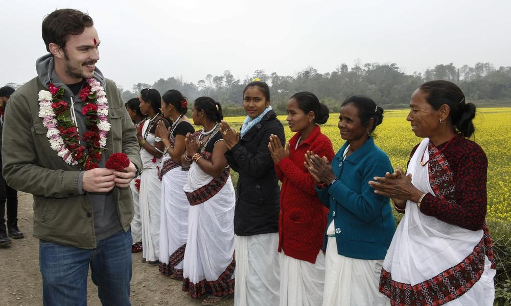 Nicholas Hoult is greeted by the Amaltari community