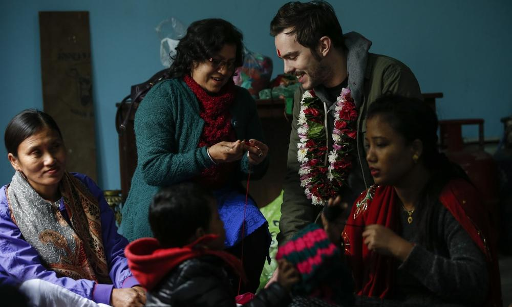 Nicholas Hoult learns to knit with Amaltari community members in Nepal.