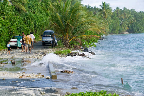 Ocean washing over a road in Tuvalu