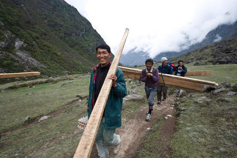 Men carrying wood in Nepal