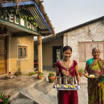 In Baghkhor, Amaltari, near Chitwan National Park, Min Kumari Gurau (left) and Rupani Devi Gurau deliver breakfast to guests at their family homestay, which is run by Min and her husband, Dahni Ram Gurau.