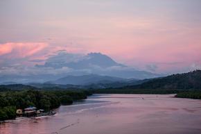 A view of Mount Kinabalu over Menkabong river, Sabah, Malaysia.