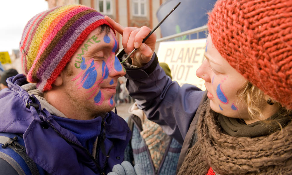 Face painting at a climate march