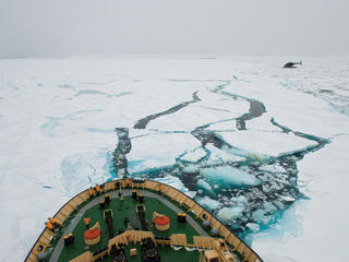 Ship moving through Arctic sea ice