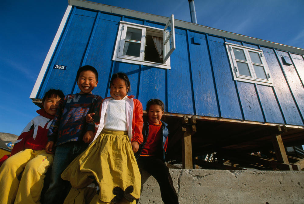 Inuit kids in front of their house
