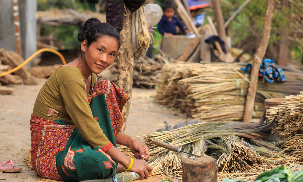 Juni Maya Bhujel making brooms at her house.