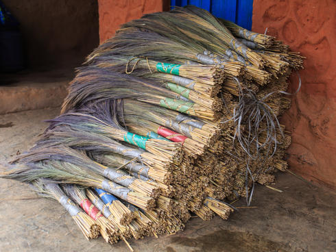 A pile of completed brooms