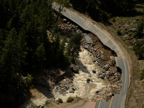 Flood damage to a road in Boulder, CO.