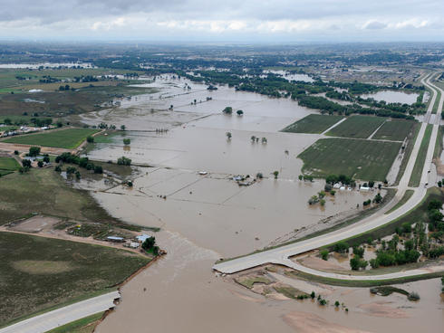 South Platte River flooding cities and farms, aerial view.