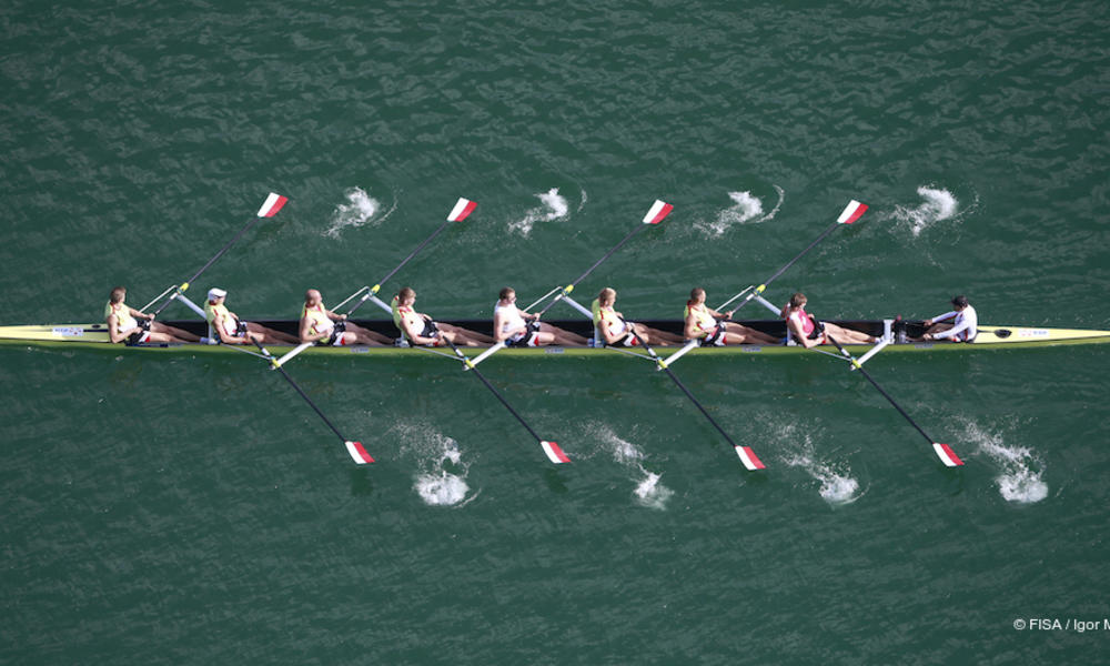 Rowers in boat.