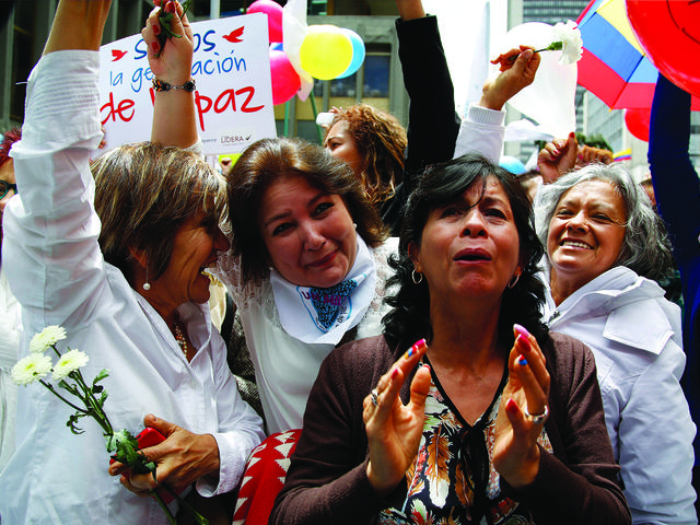 People in Bogotá celebrate the agreement between FARC and Colombia's government, June 23, 2016