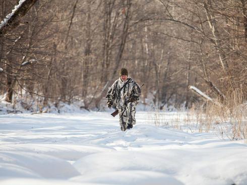 Pavel Fomenko in snow tracking Amur tiger