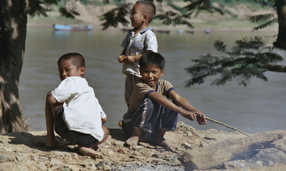Children playing by the Mekong River