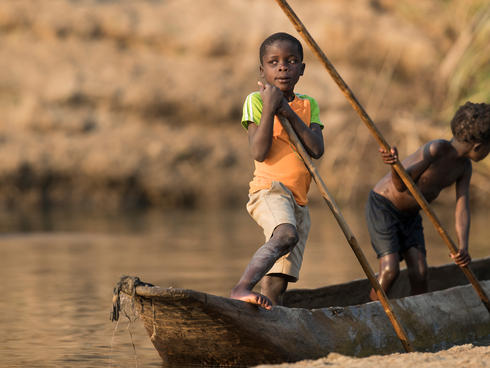 Children learn from a young age how to navigate the river - Luangwa River, Zambia