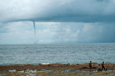 Tornado building from a cyclone over the sea. N.W. monsoon, Indonesia.