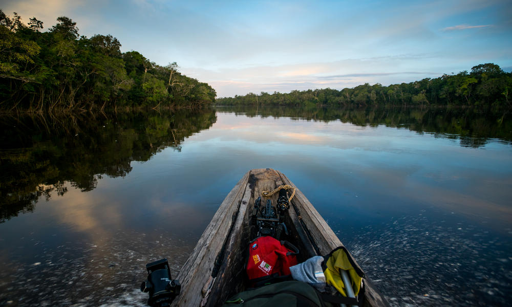 Traveling up tributary of the Orinoco River by canoe in Colombia.