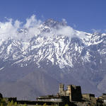 View of Jharkot Monstery near Muktinah, with snow-covered mountains in the background. Manang District, Annapurna Area, Nepal.