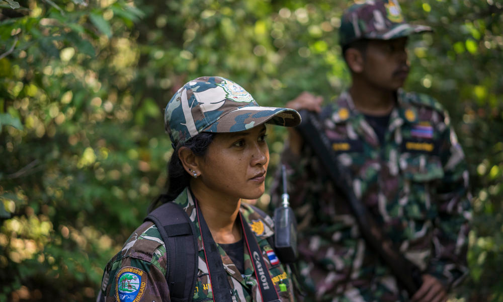Woraya Makai (34) walks through the jungle during of a morning patrol together with a team of rangers. She's the only female ranger deployed in Kui Buri and in charge of photographing and surveying the animals she's seeing around the park.