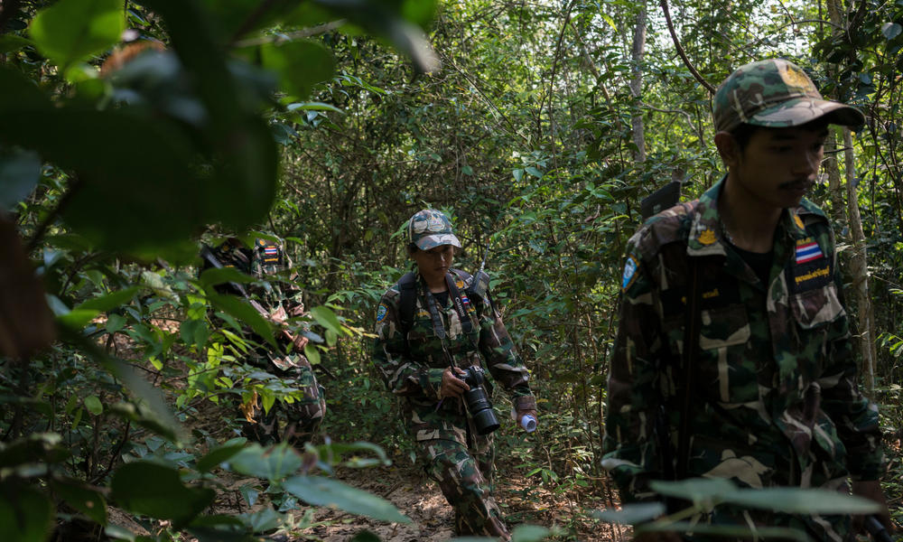 Woraya Makai (34) walks through the jungle during a morning patrol together with a team of rangers.