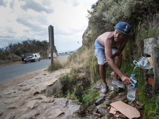 People coming from far and wide to collect water from Franschhoek spring in Cape Town, South Africa.