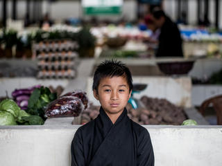 A boy in a market in Bhutan