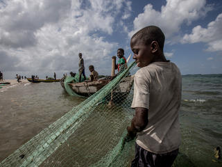 Fisherman gathers seine nets from the water on the Ilha de Mafamede, Mozambique. Mafamede is one of the protected islands that comprise Primeiras e Segundas.
