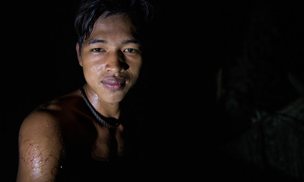 Feri, a honey famer from Talang Mamek tribe in Thirty Hills, Sumatra