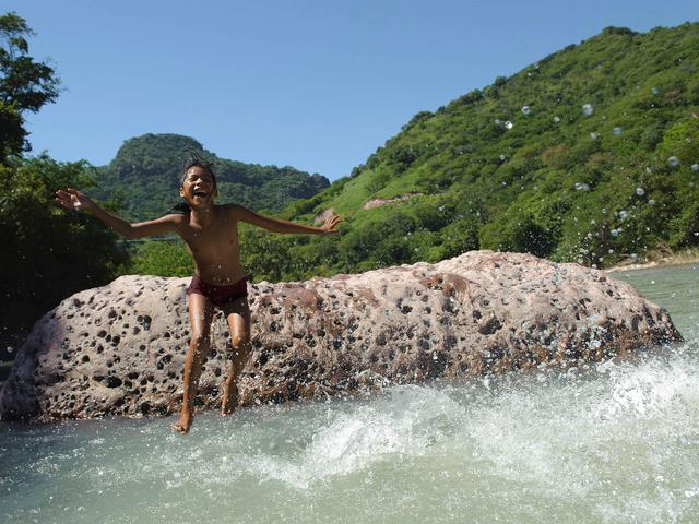 Child jumping into the water.