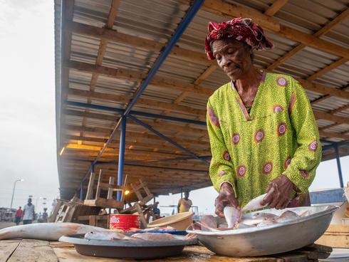 Woman selling fish at market