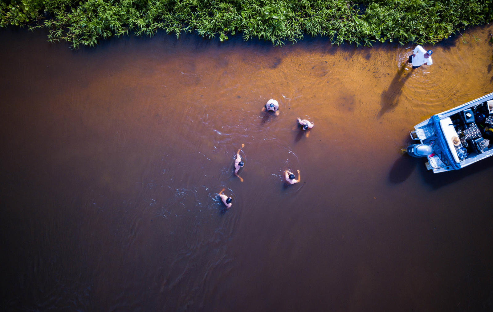 People wading in a river