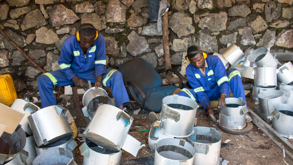 Workers shape the tin stoves
