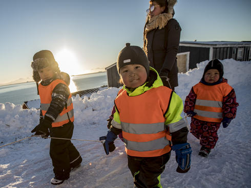Young children walking to school in Ittoqqortoormiit, Greenland.