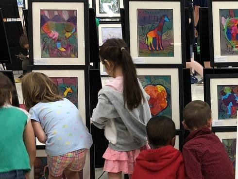 Students and artwork from an Earth Day art show