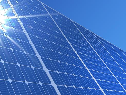 solar panels reflecting sun